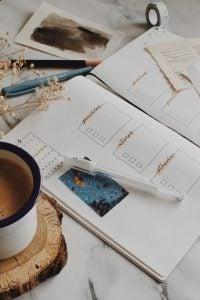 A bullet journal on a white desk
