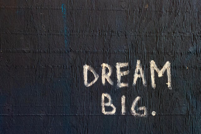 The words DREAM BIG in white text on a black background