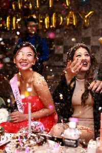 two girls at a birthday party with confetti