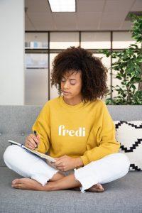 A woman sitting cross legged journaling