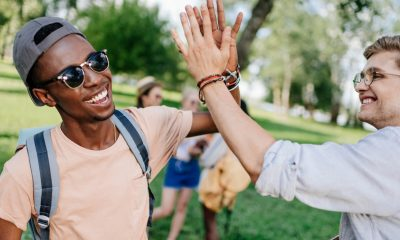Two college students high five with motivation