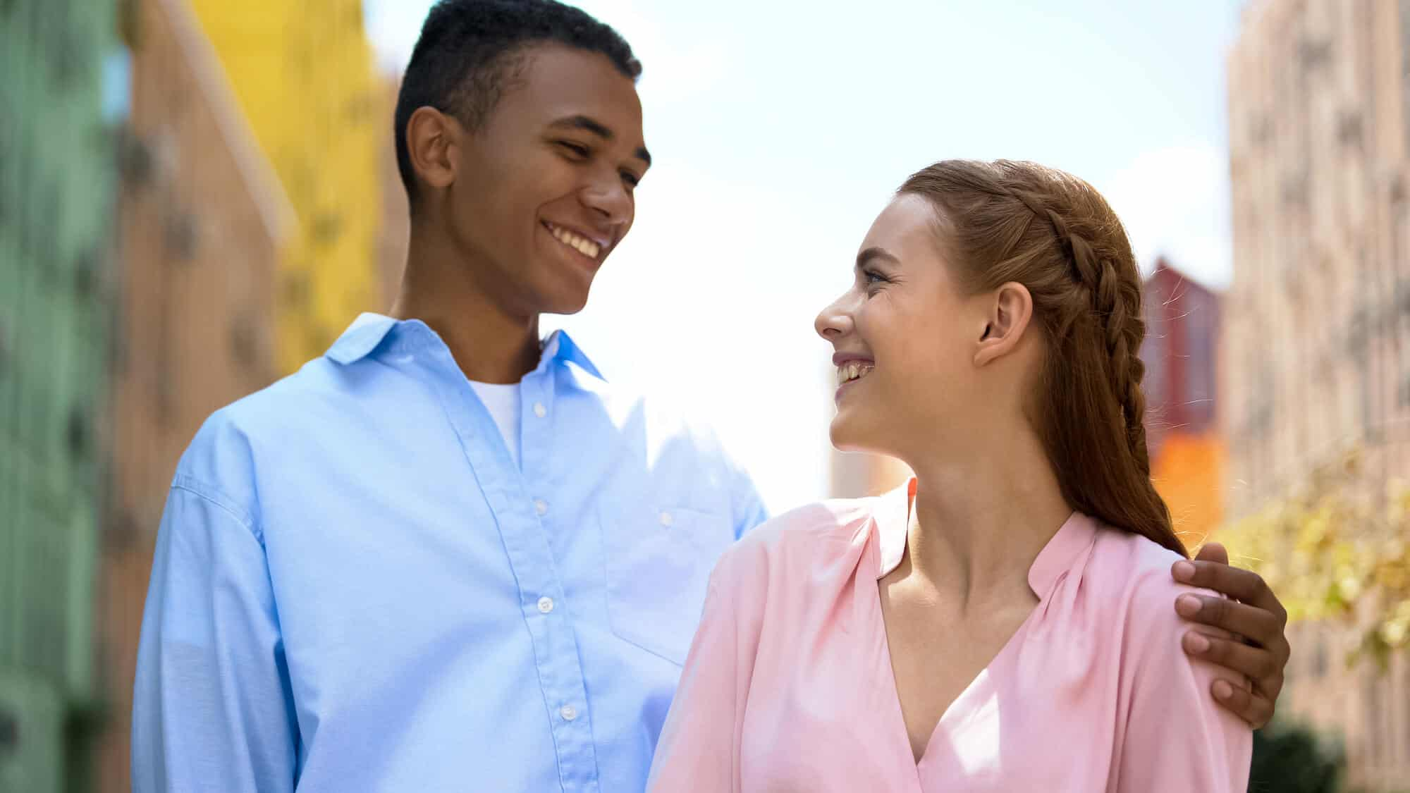 A boy and girl looking at each other and smiling