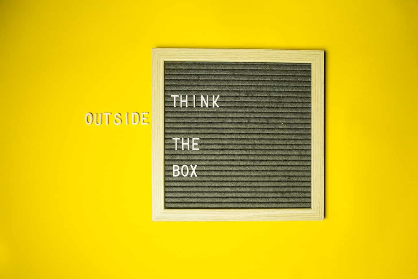 ThinkOutSIdetheBox with a yellow background