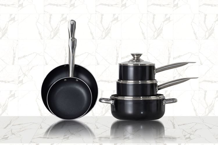 three pots next to two pans