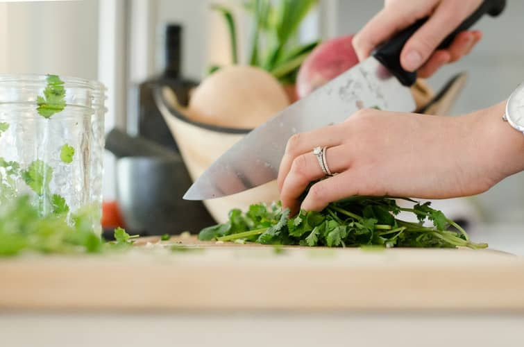 a person cutting vegetables with a knife