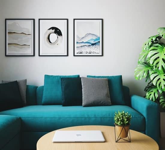 a blue couch with throw pillows