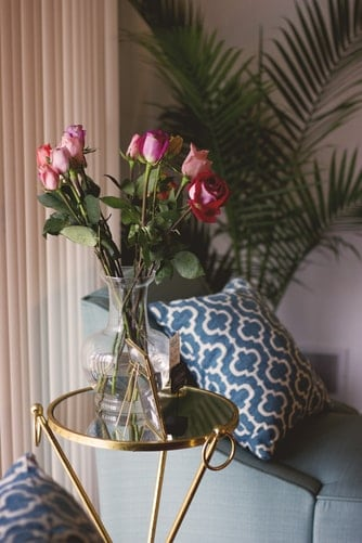 roes in a clear vase on a table