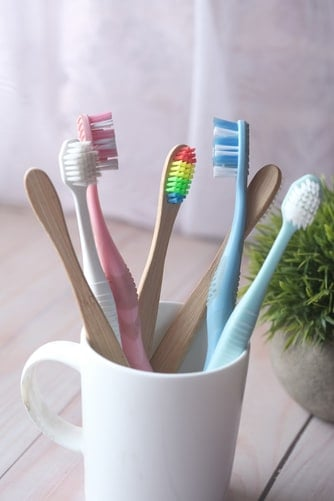 toothbrushes in a mug