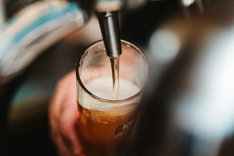 beer being filled into a glass