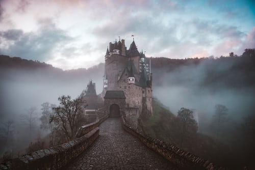 a castle in the fog