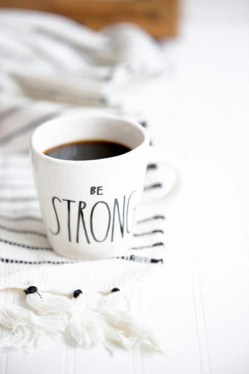 coffee in a 'be strong' coffee mug