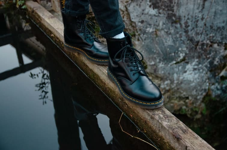 A person walking on a log