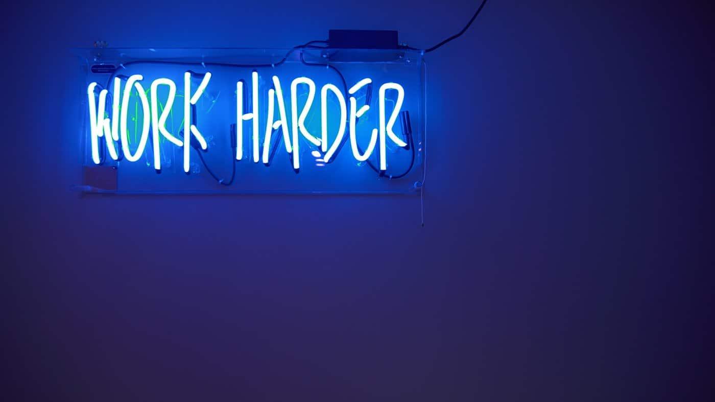 Worker Harder with a dark blue background