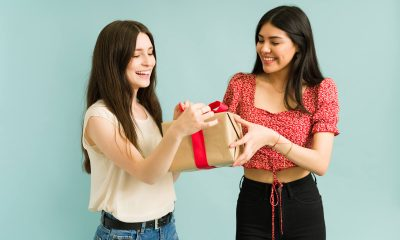 Two girls holding a present