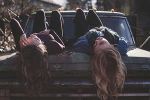 two best friend laying on a truck