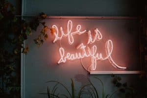 Pink Neon light sign that says life is beautiful
