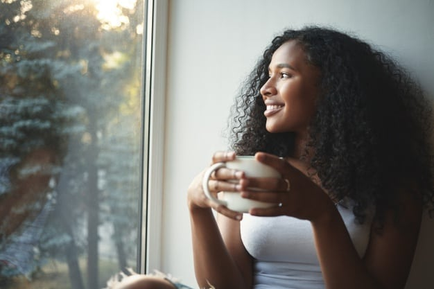 dark-skinned woman with a mug in her hands