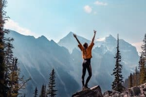 Woman standing up on the mountain
