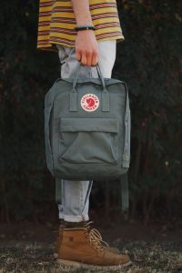 Man with a gray minimalist backpack